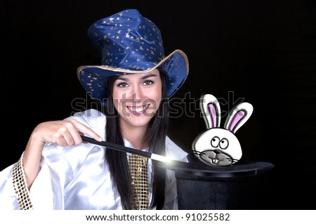 Attractive woman with a magic wand and hat isolated on a over white background - stock photo