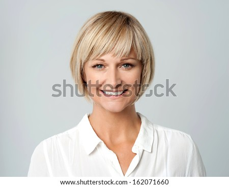 Attractive woman with a radiant smile - stock photo