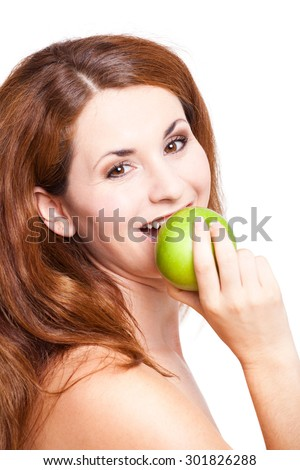 attractive woman with an apple on isolated background