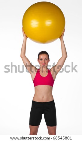 attractive woman with big pilates ball - stock photo