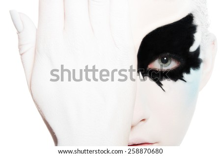 attractive woman with black and white face art isolated on white - stock photo