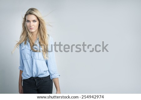 Attractive woman with blond hair - stock photo
