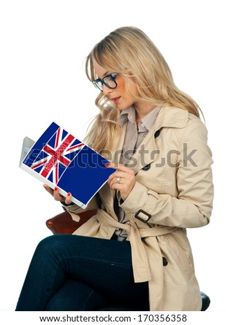 attractive woman with book learning english language