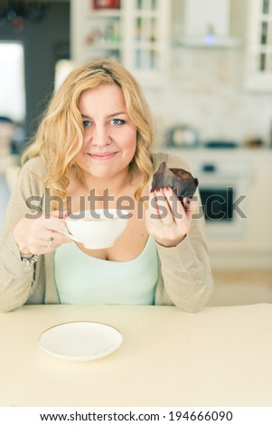 attractive woman with coffee and dessert