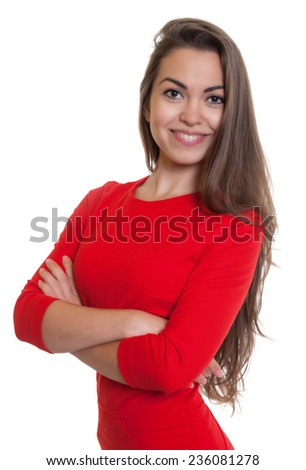 Attractive woman with crossed arms  in a red dress - stock photo