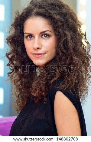 attractive woman with curly hair beauty portrait - stock photo