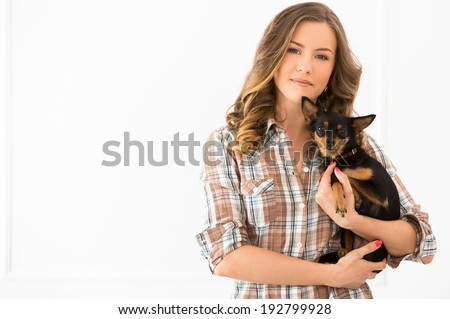 Attractive woman with dog - stock photo