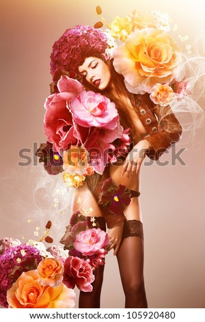 attractive woman with flowers - stock photo