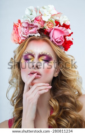 Attractive woman with flowers on her head close-up - stock photo