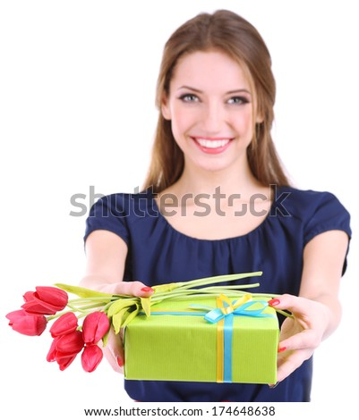 Attractive woman with gift box and flowers, isolated on white