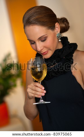 attractive woman with glass of white wine