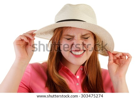 Attractive woman with hat giving expression - stock photo