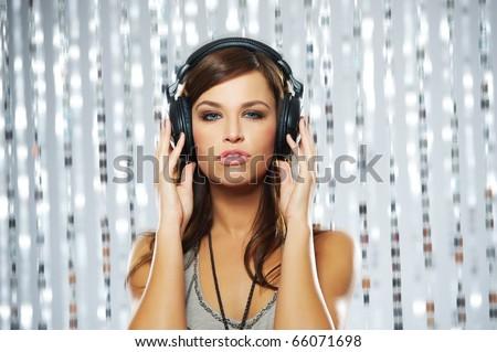 Attractive woman with headphones - stock photo