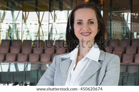 Attractive woman with headset working in office, portrait