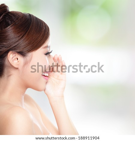 attractive woman with health skin and teeth, she is happy talk to you with nature green background, asian - stock photo