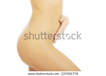 Attractive woman with her hands on her belly.