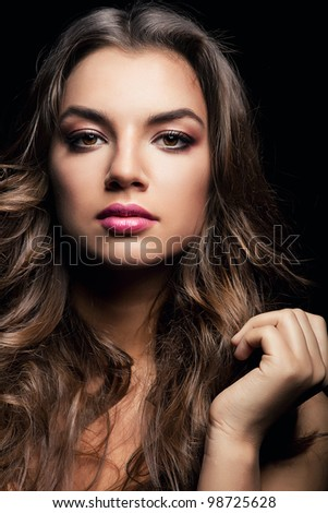 attractive woman with long curly hair - stock photo