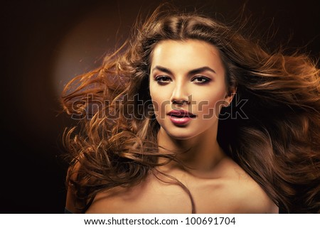 attractive woman with long hair and sexy smile - stock photo