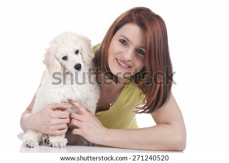 Attractive woman with poodle puppy isolated on white