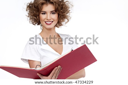attractive woman with red folder - stock photo