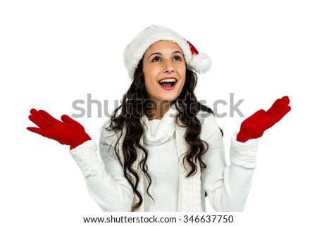 Attractive woman with red gloves looking up with raised hands on white screen - stock photo