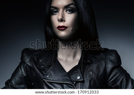 attractive woman with red lips in jacket