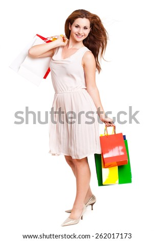 attractive woman with shopping bags on isolated background