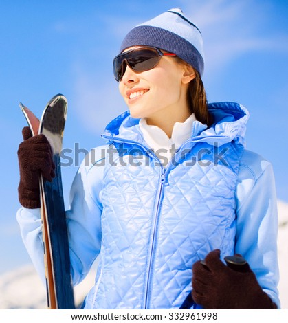 Attractive woman with ski at the mountains