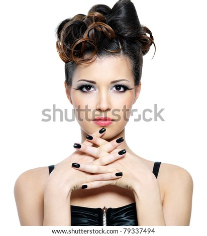 Attractive  woman with stylish hairstyle and black nails. Fashion eye make-up
