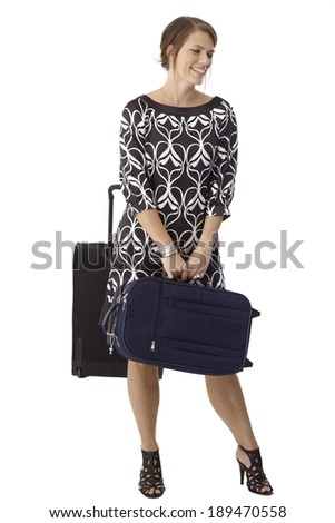 Attractive woman with travel bags. Smiling, dress, high heels, luggage. Isolated on white. - stock photo