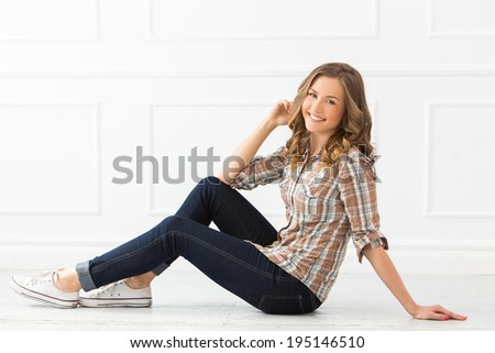 Attractive woman with wide smile - stock photo