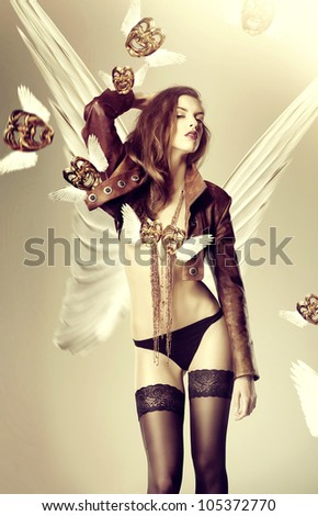 attractive woman with wings and flying venetian masks
