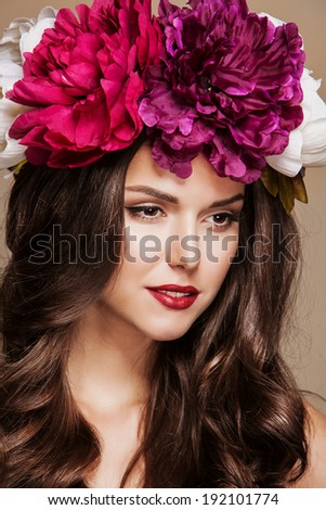 attractive woman with wreath of peonies on her head