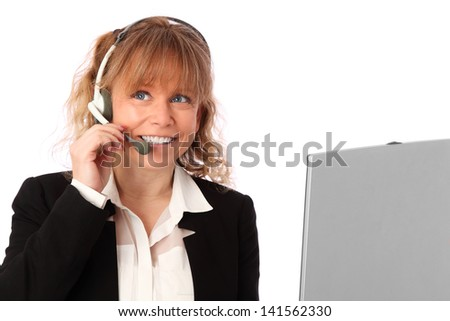 Attractive woman working with a laptop and a head set. Wearing a black jacket and white shirt. White background. - stock photo