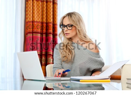 attractive woman writer in her home with laptop thinking expression