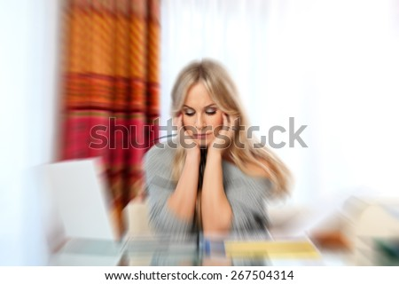 attractive woman writer in her home with laptop thinking expression,zoomed for dramatic effect - stock photo