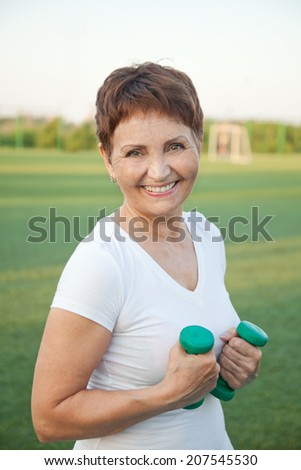 attractive woman 50 years doing fitness - stock photo