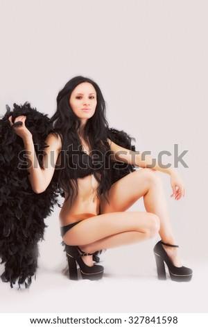 attractive women in black. dark angel - stock photo