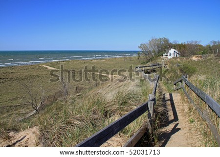 Attractive wooden boardwalk atop the sand dunes along Lake Michigan in New Buffalo, Michigan - stock photo