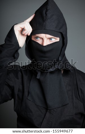 Attractive 30 years old caucasion man shot in studio isolated on a grey background