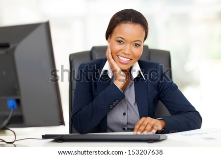 attractive young african businesswoman in office - stock photo