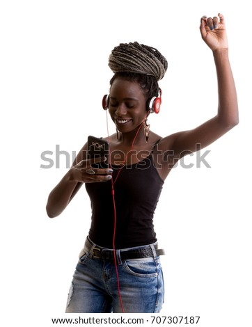 Attractive young afro woman listening music