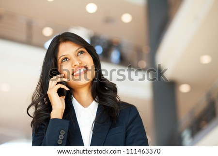 attractive young asian businesswoman talking on mobile phone - stock photo