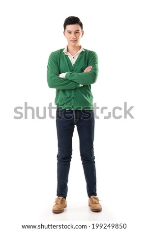 Attractive young Asian man, full length portrait isolated on white background.