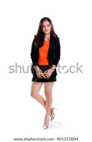 Attractive young Asian office lady standing and looking to her side, full length shot isolated on white background - stock photo