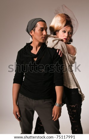 Attractive young Asian woman and Hispanic man