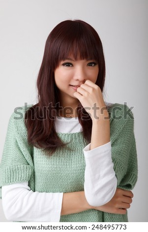Attractive young asian woman, closeup portrait.