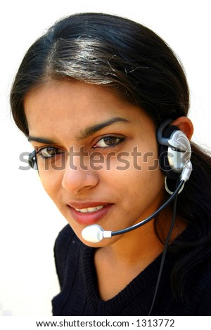 Attractive young asian woman wearing headset on white background - stock photo