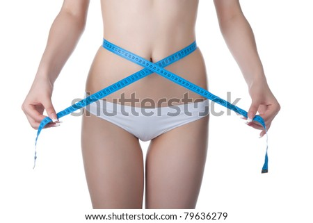 Attractive young athletic and sexy woman measuring size of her waist with a tape measure. Isolated on white background. Fitness people healthy lifestyles concept - stock photo