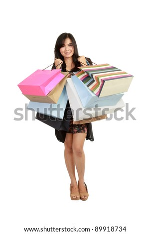 Attractive Young beautiful asian Woman with Shopping Bags in white background